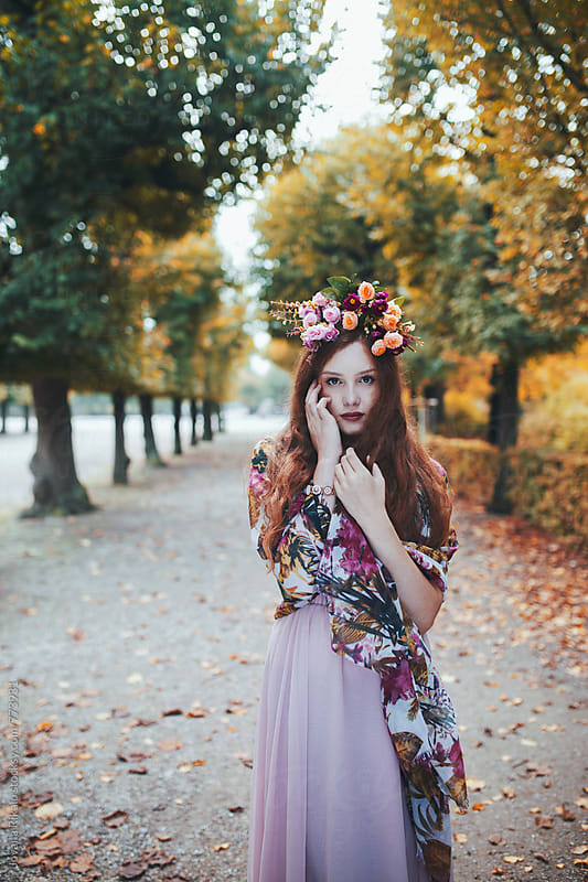 Beautiful young woman wearing flower crown by Jovana Rikalo for Stocksy United