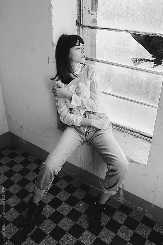 Black and white photo of fashionable young woman by Jovana Rikalo for Stocksy United