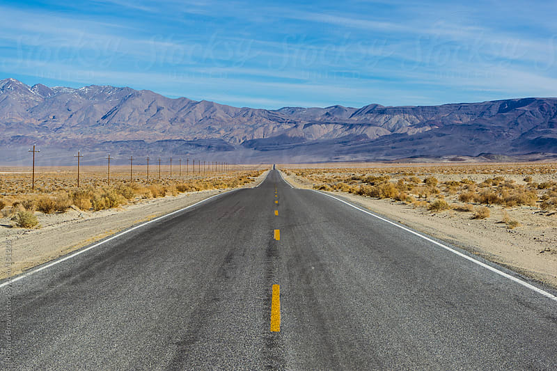 Deserted highway in death valley by Richard Brown for Stocksy United