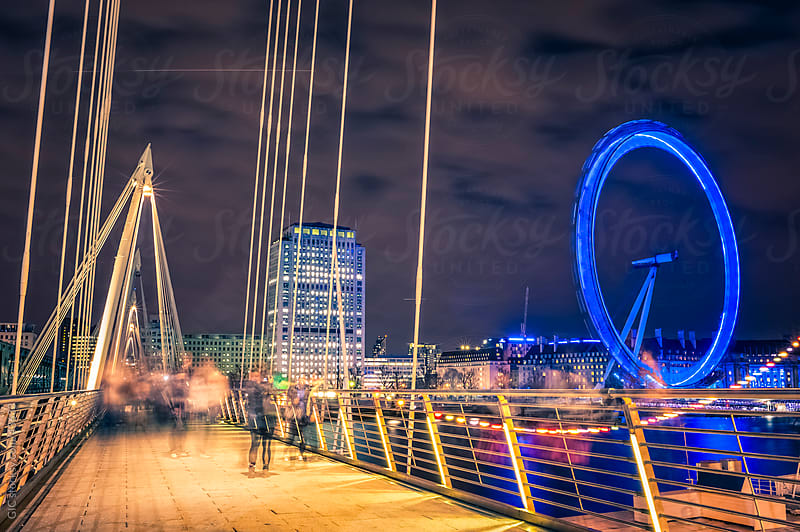 Bridge and Millenium Wheel in London by night by GIC for Stocksy United