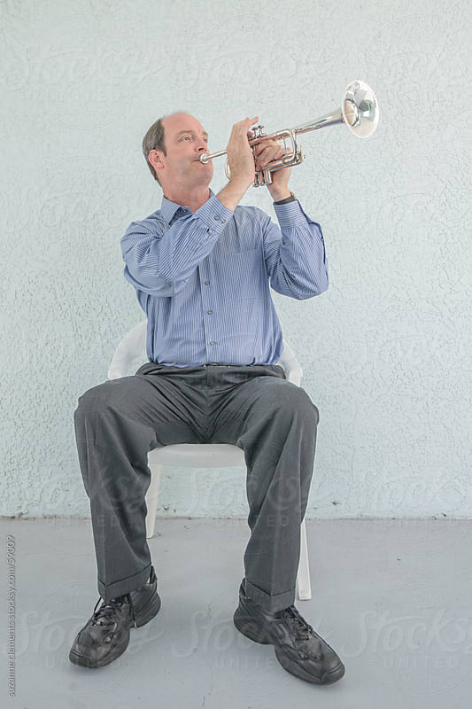 Portrait of a Musician and his Trumpet by suzanne clements for Stocksy United