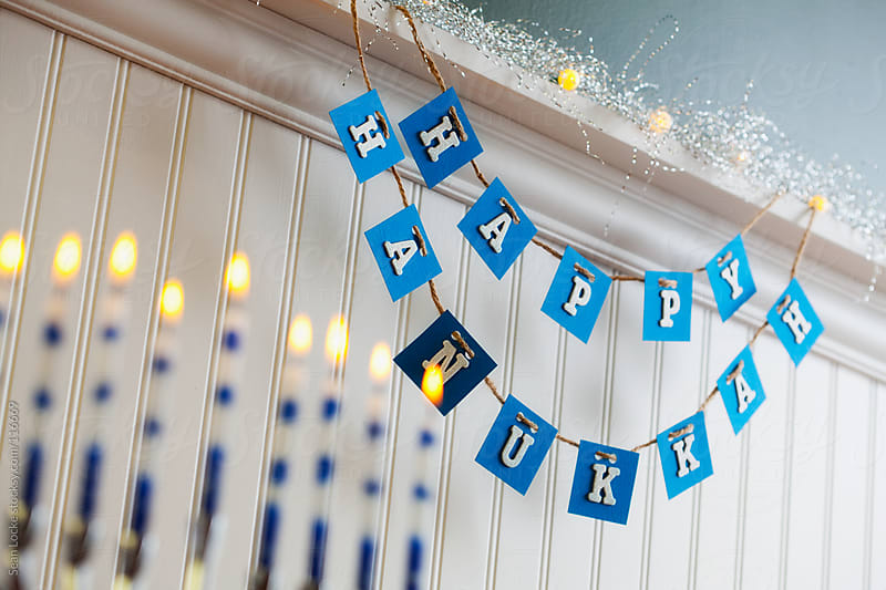 Holidays: Happy Hanukkah Sign With Menorah in Foreground by Sean Locke for Stocksy United