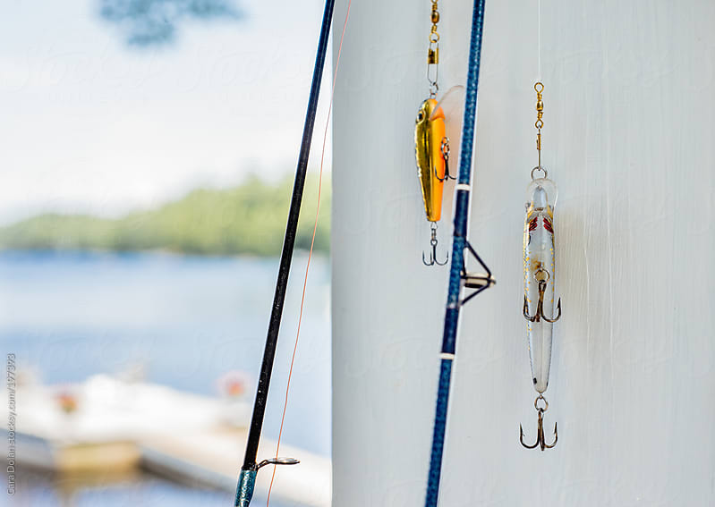 Fishing poles at the lake by Cara Dolan for Stocksy United