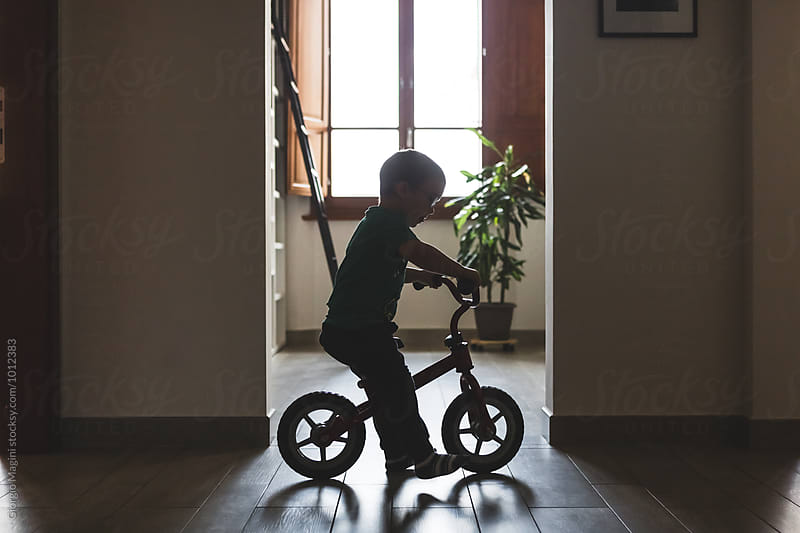 Toddler Riding a Bike Without Pedals at Home by Giorgio Magini for Stocksy United