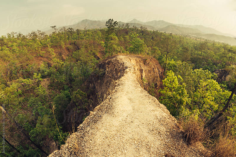 Tropical mountain landscape with narrow walking trail in Thailan by Søren Egeberg Photography for Stocksy United