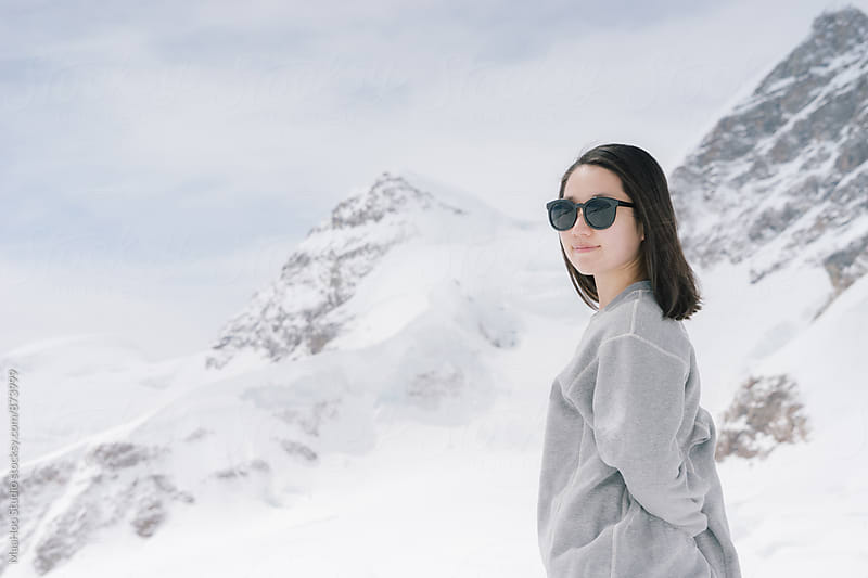 Profile of a young woman,Swiss Alps, Switzerland by MaaHoo Studio for Stocksy United