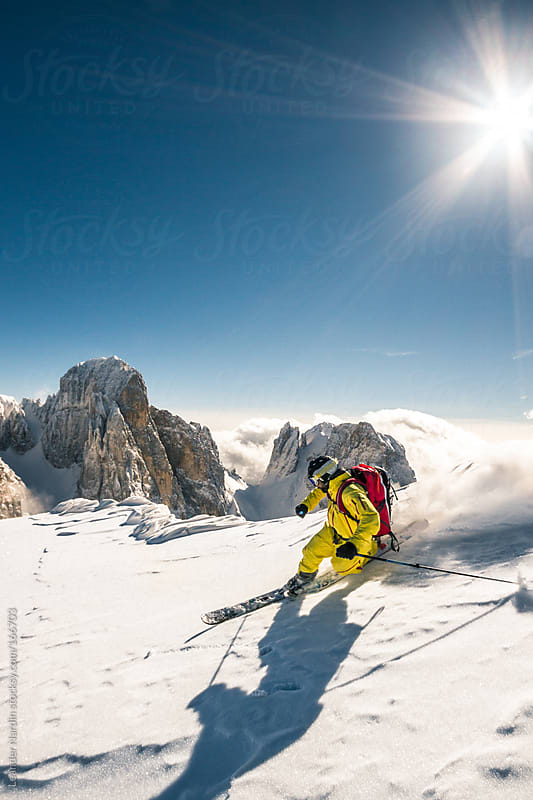 telemark skiing in big mountains  by Leander Nardin for Stocksy United