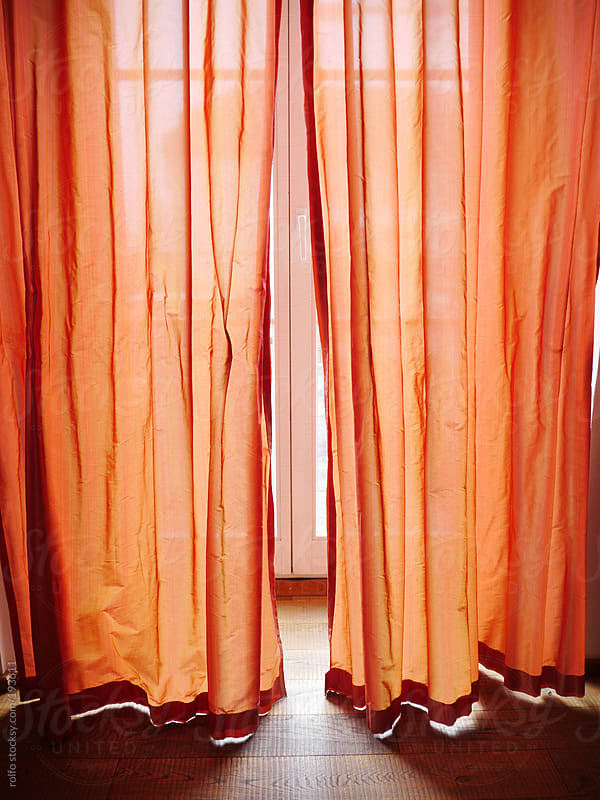 red curtains by rolfo for Stocksy United