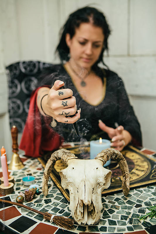 Witch or Psychic casting a spell to predict the future by kkgas for Stocksy United