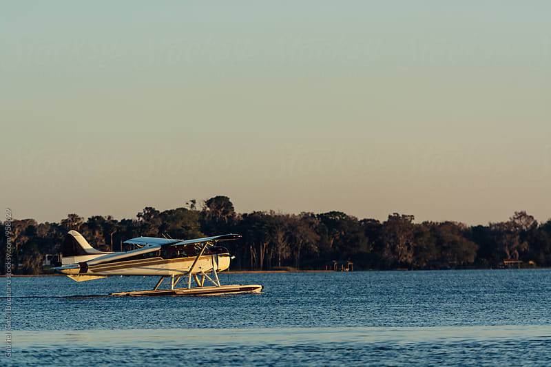 Floatplane floating on water by Gabriel (Gabi) Bucataru for Stocksy United