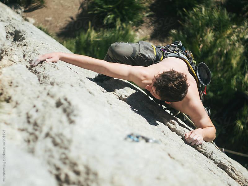 Half naked man climbing in el chorro rocks in spain by Martin Matej for Stocksy United