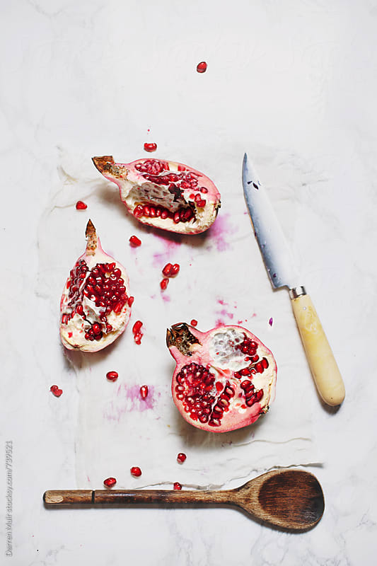 Deconstructed pomegranate on white background. by Darren Muir for Stocksy United