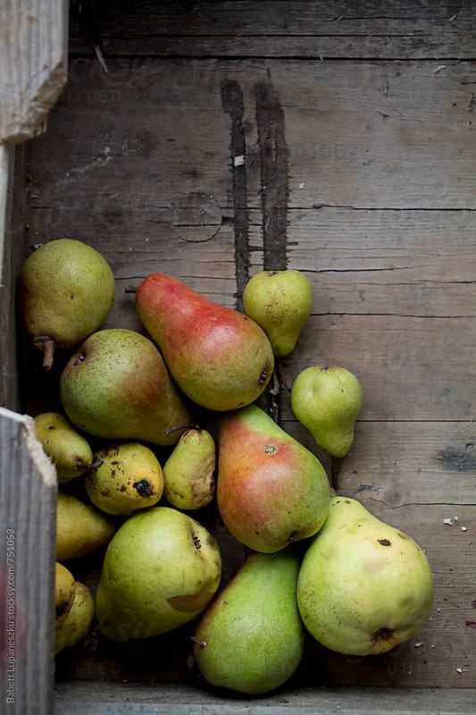 Organic pears in the crate by Babett Lupaneszku for Stocksy United