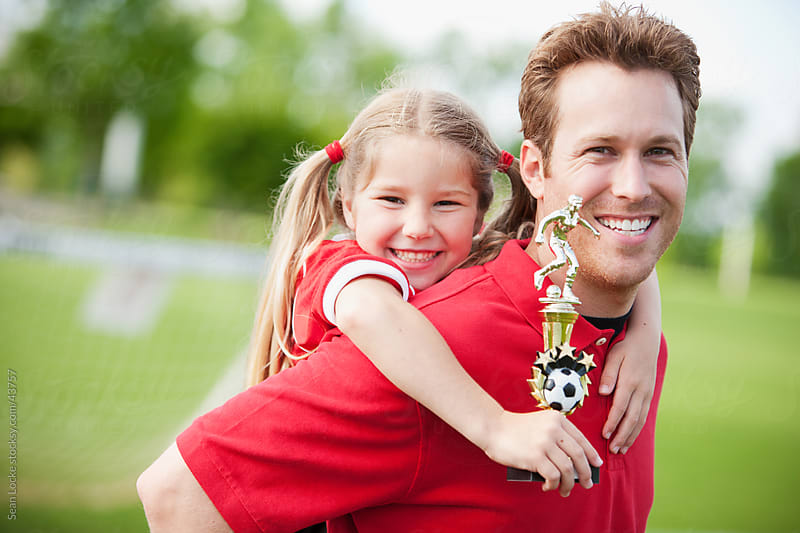 Soccer: Girl and Coach Win Trophy by Sean Locke for Stocksy United