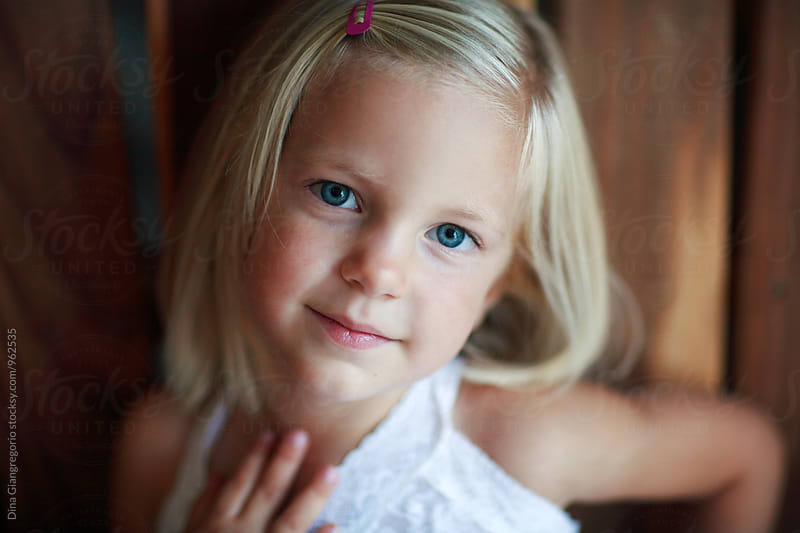 Portrait of Blonde Child Wearing White by Dina Giangregorio for Stocksy United
