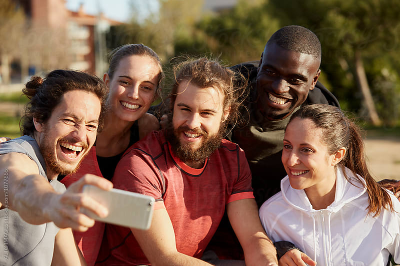 Cheerful Man Talking Selfie With Friends In Park by ALTO IMAGES for Stocksy United