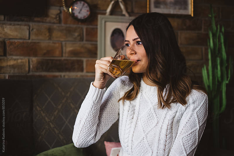 Beautiful Brunette Woman Drinking Tea by Katarina Radovic for Stocksy United