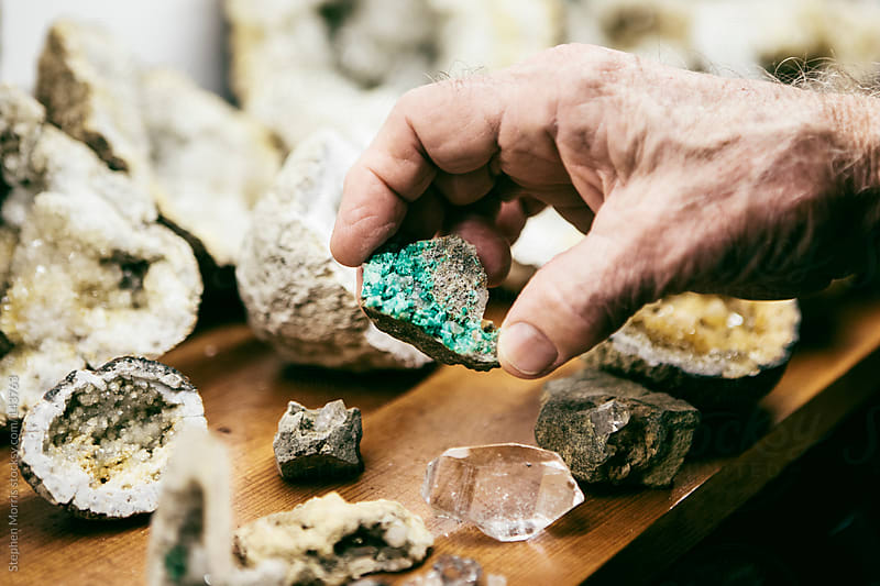 Man holding raw emerald by Stephen Morris for Stocksy United