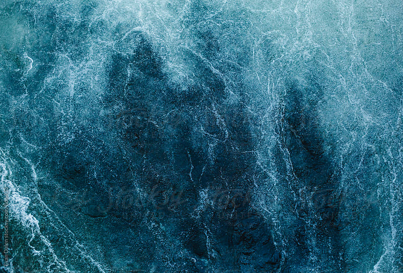 Foaming Surface of Raging River by Evan Dalen for Stocksy United