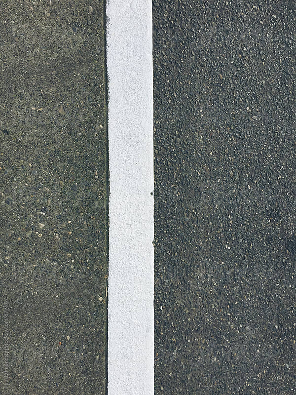 Close up of freshly painted street curb by Paul Edmondson for Stocksy United