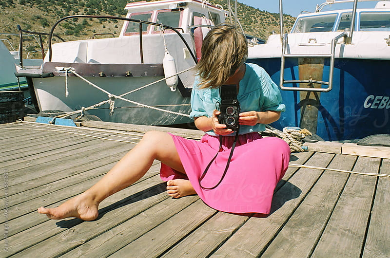 The portrait of a young woman taking photo with old analog camera by Anna Malgina for Stocksy United