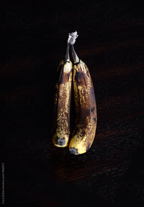 Two overripe bananas by Cara Dolan for Stocksy United