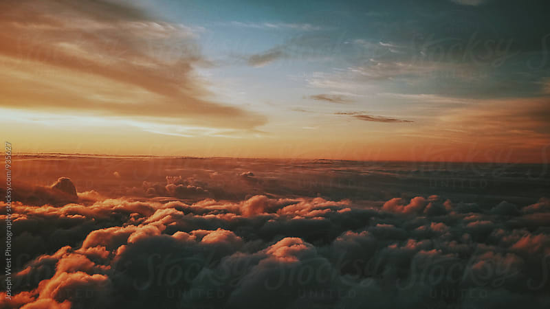 Sunset from above the clouds by Joseph West Photography for Stocksy United