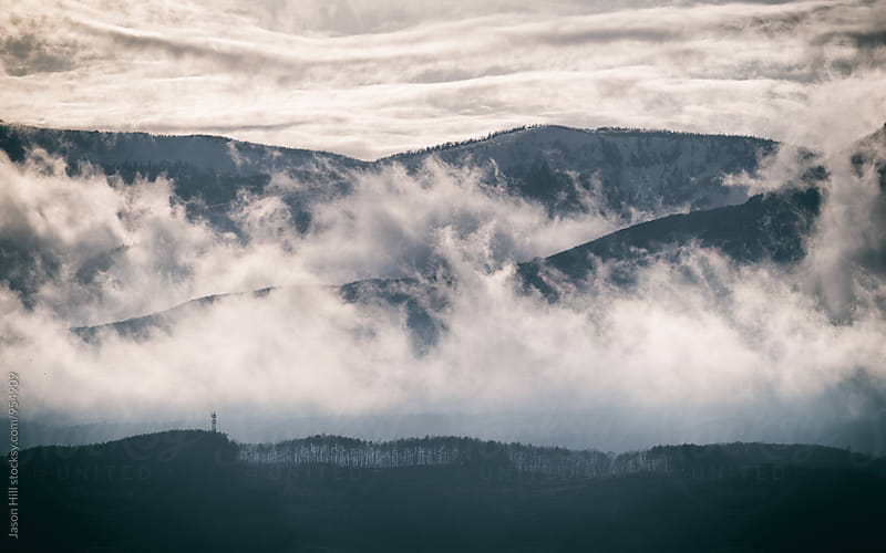 Low Clouds in the Mountains by Jason Hill for Stocksy United