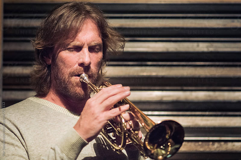 Portrait of professional trumpet player by Per Swantesson for Stocksy United