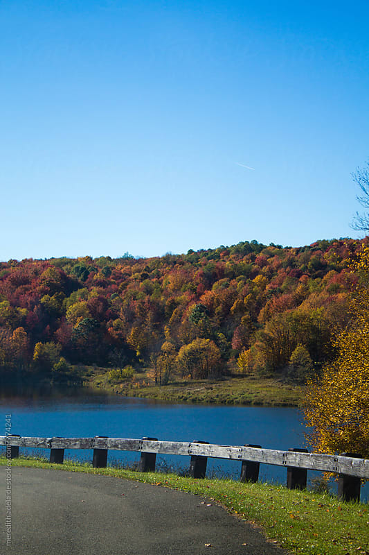 Lake Overlooking Colorful Autumn Hills by meredith adelaide for Stocksy United