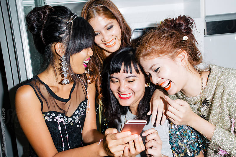 Girls laughing on the video clip on the phone by Nabi Tang for Stocksy United
