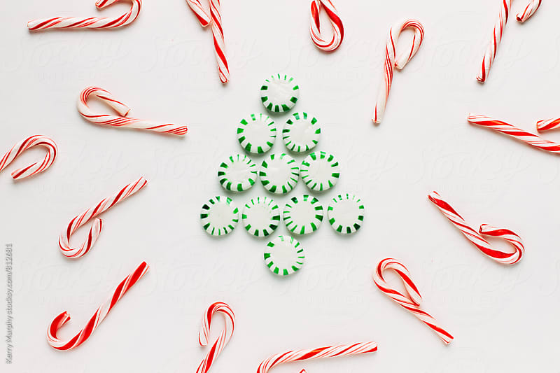 Peppermint candies in tree design on white by Kerry Murphy for Stocksy United