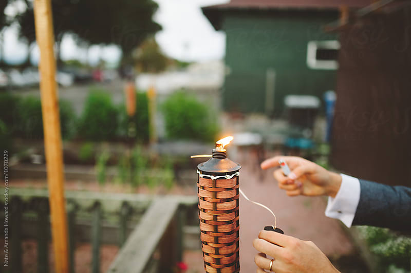 tiki torch by Nate & Amanda Howard for Stocksy United