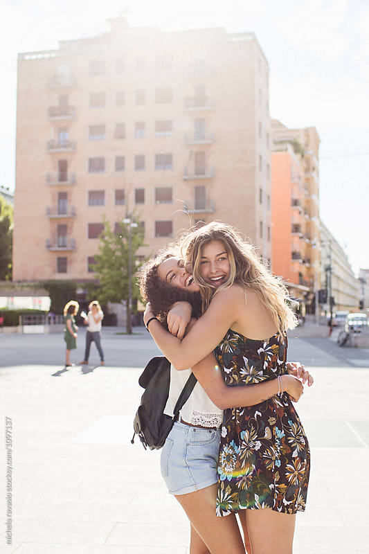 Affectionate female friends hugging each other by michela ravasio for Stocksy United