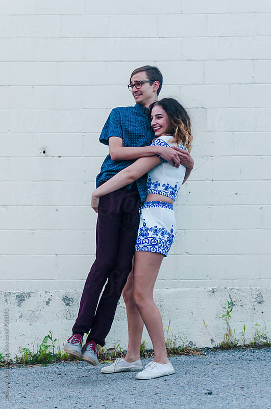 Cute young couple holding each other by Chelsea Victoria for Stocksy United