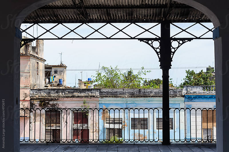 Street facade seen from a balcony in Cardenas, Cuba by Amanda Large for Stocksy United