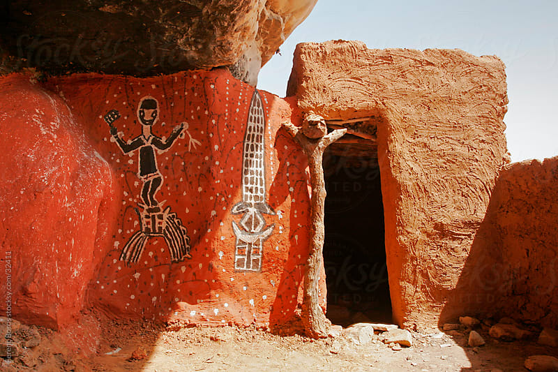 Dogon wall painting with iconic colors and animistic ritual figu by Ferenc Boros for Stocksy United