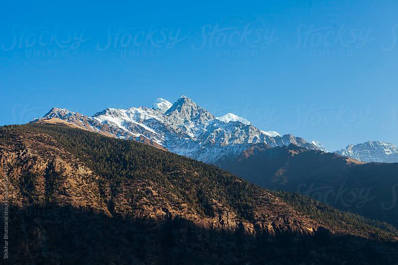 Mt. Nilgiri towering above in the himalayas. by Shikhar Bhattarai for Stocksy United