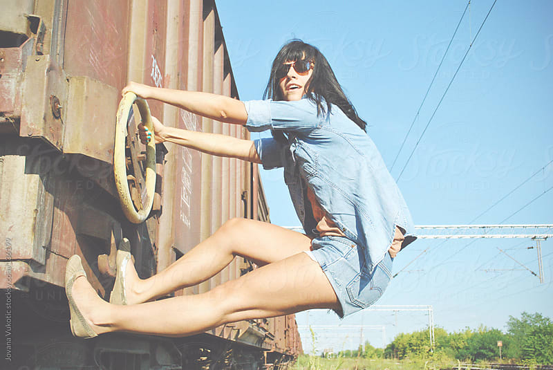 young girl on train by Jovana Vukotic for Stocksy United
