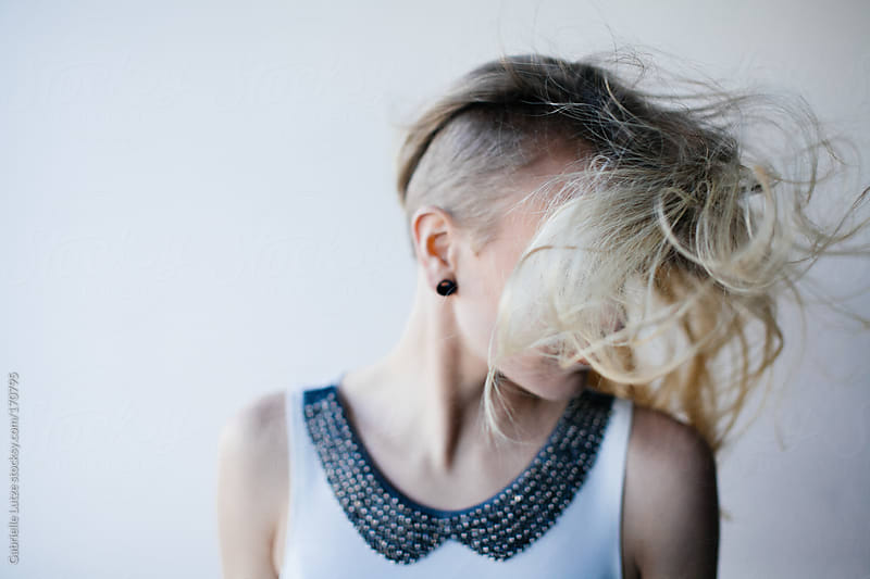 Beautiful Blond Woman with Hair Flowing/Flying by Gabrielle Lutze for Stocksy United