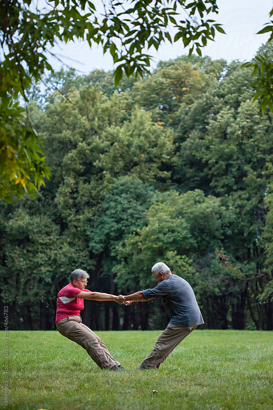 Senior people exercise in the park by Jelena Jojic Tomic for Stocksy United