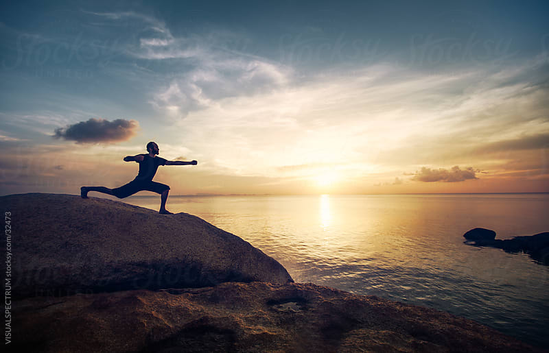 Yoga: Man Performing Warrior Pose at Sunset by Julien L. Balmer for Stocksy United