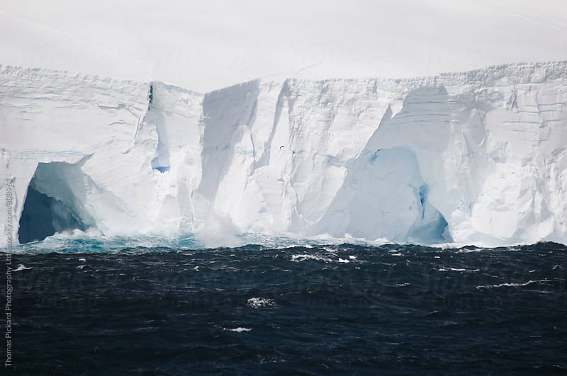 Ocean and iceberg, Antarctica. by Thomas Pickard for Stocksy United