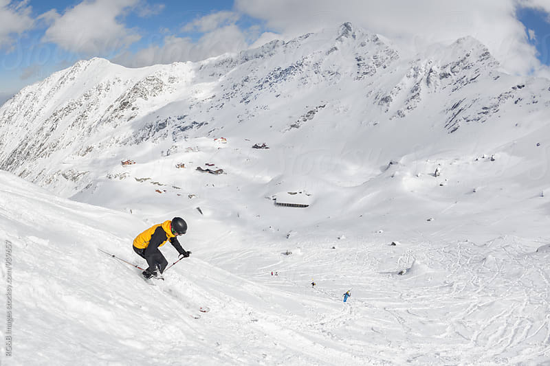 Skier freeriding off-piste in the mountains by RG&B Images for Stocksy United