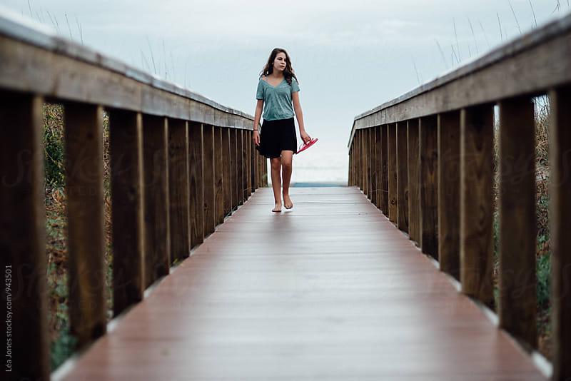 girl walking on boardwalk by Léa Jones for Stocksy United