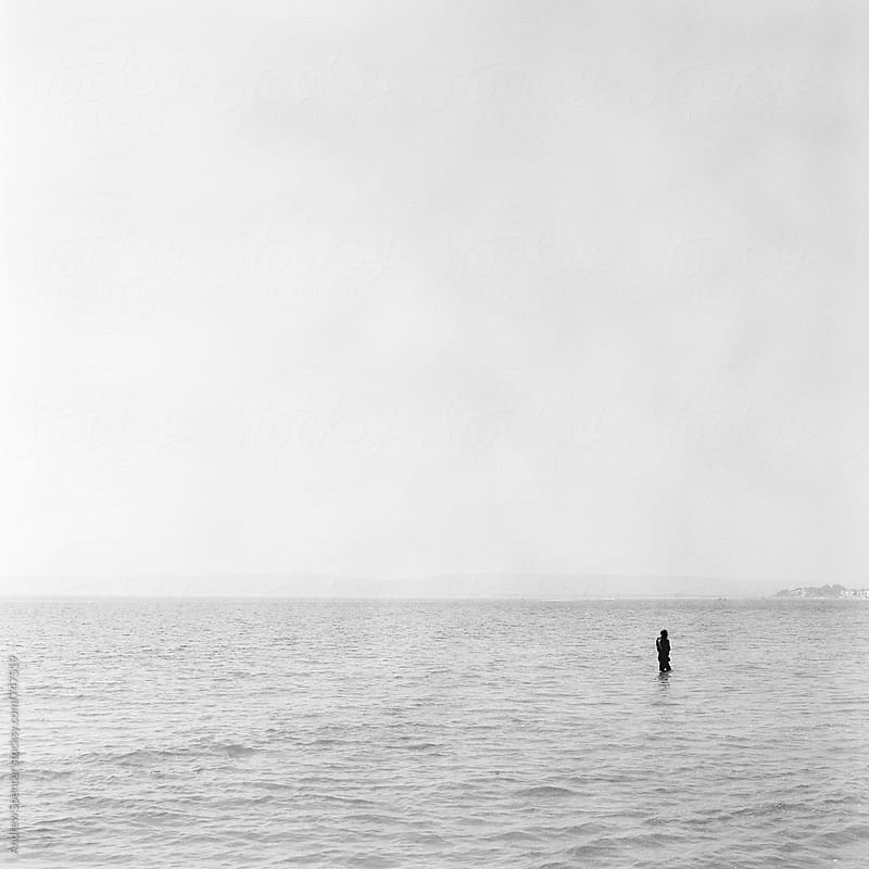 Lonely Surfer by Andrew Spencer for Stocksy United