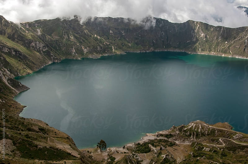 Large volcanic lake with green water. by Mike Marlowe for Stocksy United