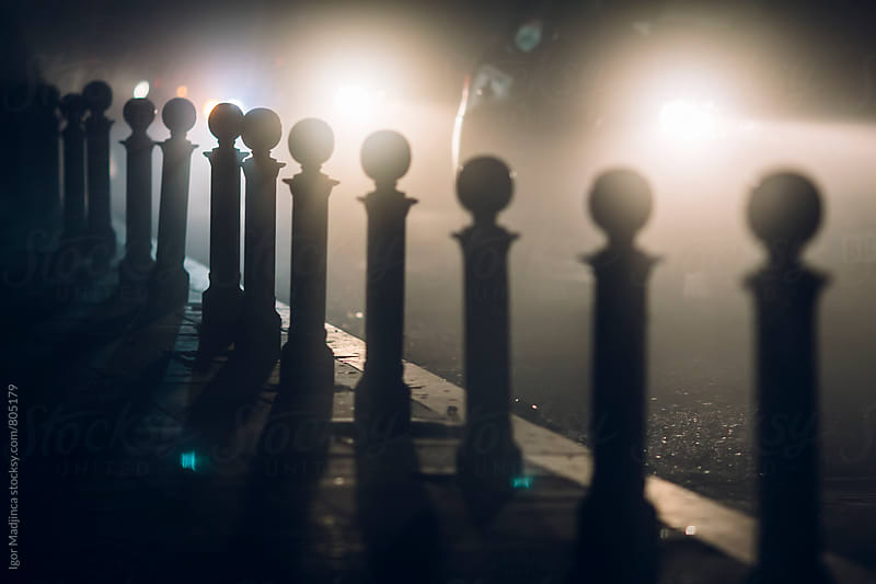 foggy night in the city, vehicles, atmosphere, cold by Igor Madjinca for Stocksy United