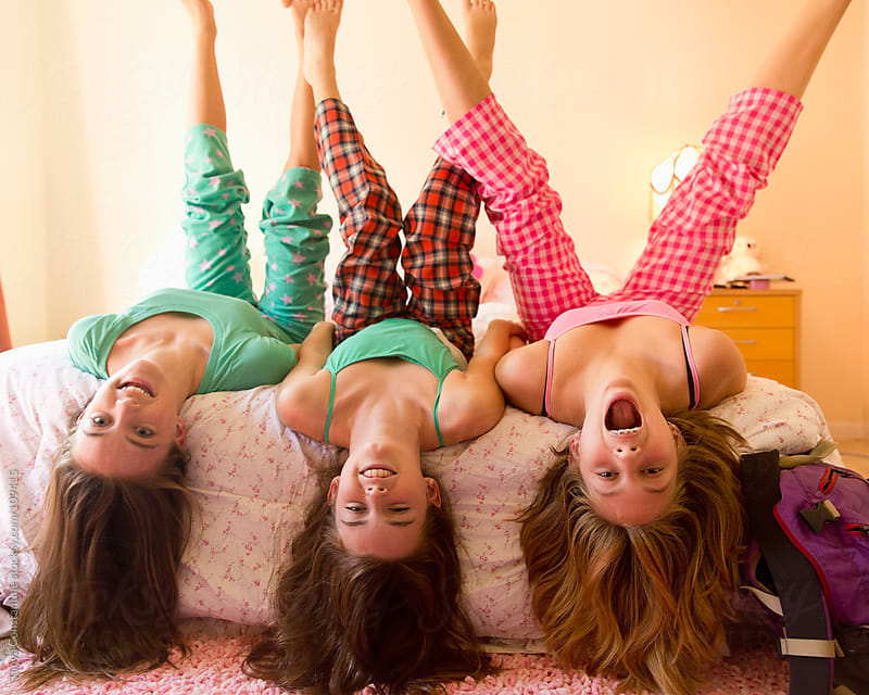 three tweens being silly by Tanya Constantine for Stocksy United