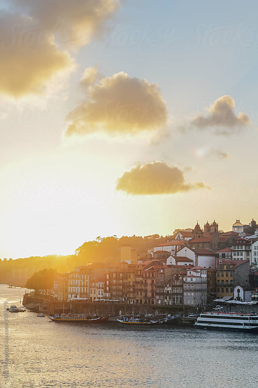 Ribeira and Douro river at sunset, Porto, Portugal by Luca Pierro for Stocksy United